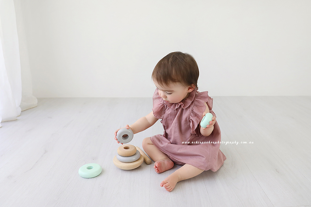 Baby Girl playing with toys at her shoot